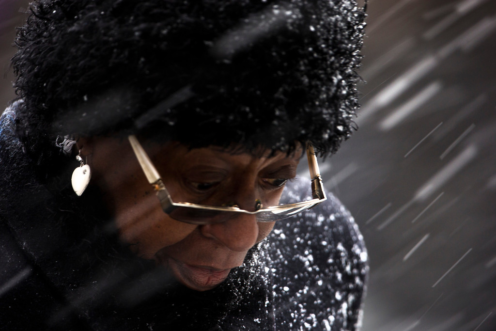 . A woman crosses Market Street during a winter snow storm Friday, March 8, 2013, in Philadelphia. Many areas in the state reported 4 to 6 inches of snow. (AP Photo/Matt Rourke)