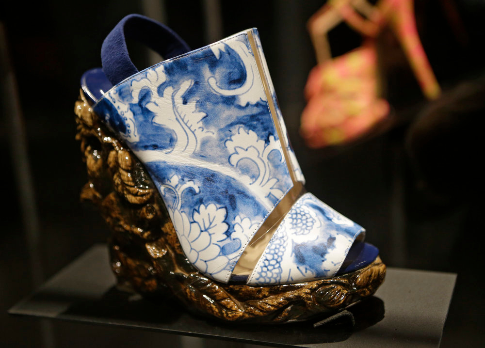 Description of . A shoe designed by Nicholas Kirkwood for the Rodarte spring 2011 fashion show that has the appearance of antique ceramic ware is displayed at the