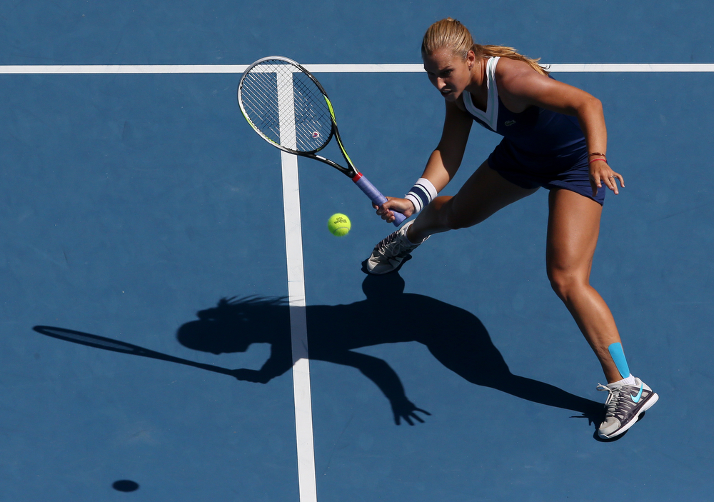 . Dominika Cibulkova of Slovakia hits a forehand return to Agnieszka Radwanska of Poland during their semifinal at the Australian Open tennis championship in Melbourne, Australia, Thursday, Jan. 23, 2014.(AP Photo/Eugene Hoshiko)