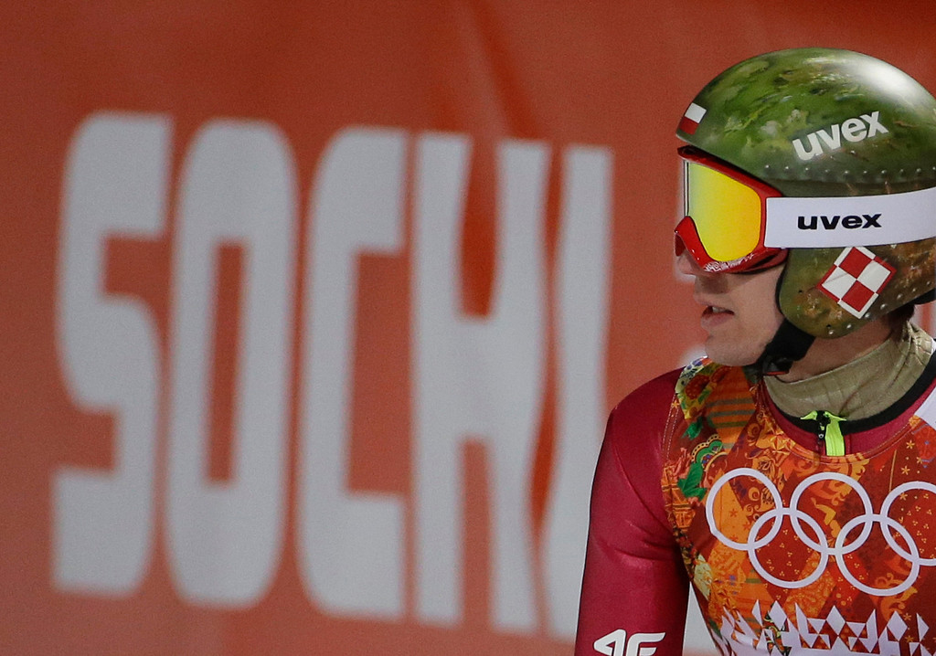 . Poland\'s Kamil Stoch checks the scoreboard after an attempt during the men\'s normal hill ski jumping qualification at the 2014 Winter Olympics, Saturday, Feb. 8, 2014, in Krasnaya Polyana, Russia. (AP Photo/Gregorio Borgia)