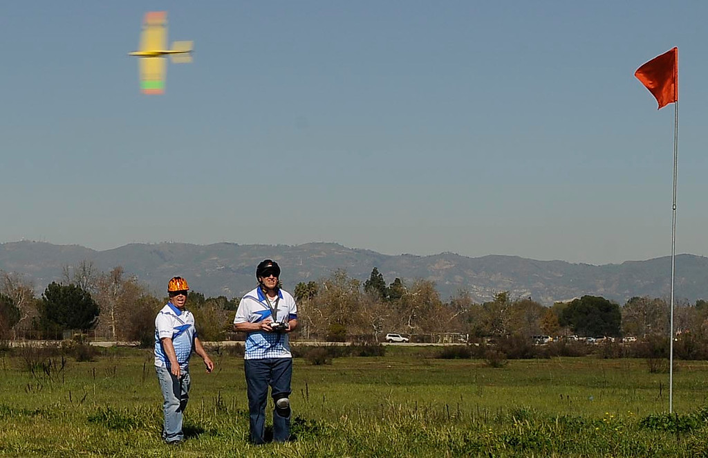 . Dan Thordarson of Saugus, and Chuck Andrka from New Mexico, fly around a pylon. Dozens of model aviation enthusiasts are participating in the National Miniature Pylon Racing Association\'s Basin Q40 Classic. Pilots are testing their skills at the Sepulveda Basin Recreation Area where they guide their aircraft by remote control around pylons at speeds in excess of 170 mph.Van Nuys, CA 2/23/2013(John McCoy/Staff Photographer)