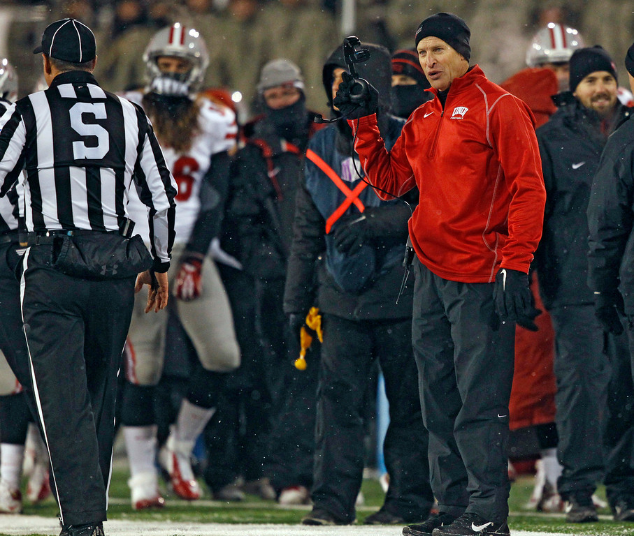 . UNLV head coach Bobby Hauck, right, argues for a call against Air Force with side judge Craig Falkner in the first quarter of an NCAA football game at Air Force Academy, Colo., on Thursday, Nov. 21, 2013. (AP Photo/David Zalubowski)