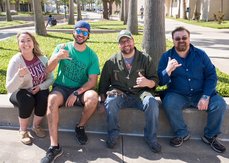 Kristen Deatherage (left), David Molina, Phil Jose and Lee Lehman throw up their best shakas as they take Lord Saladin outside for some sun and fresh air.