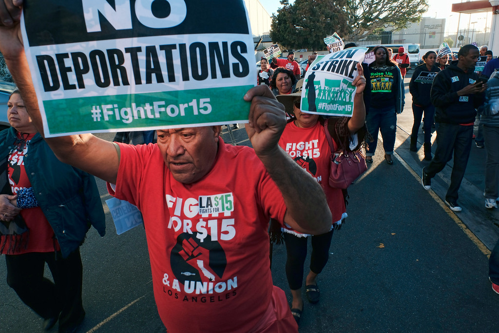 ". Protesters carrying signs and chanting slogans march during a wage protest in downtown Los Angeles on Tuesday, Nov. 29, 2016. Forty protesters were arrested as they blocked a downtown Los Angeles intersection as part of a national wave of demonstrations in support of higher wages and workers\' rights. About a hundred demonstrators formed a circle in the street early Tuesday and hoisted signs saying ""the whole world is watching\"" and \""Fight for $15.\"" (AP Photo/Richard Vogel)"