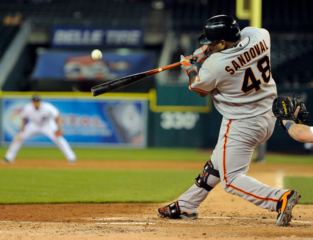 . San Francisco Giants� Pablo Sandoval hits a home run against the Detroit Tigers in the sixth inning of a baseball game Friday, Sept. 5, 2014, in Detroit. (AP Photo/Jose Juarez)