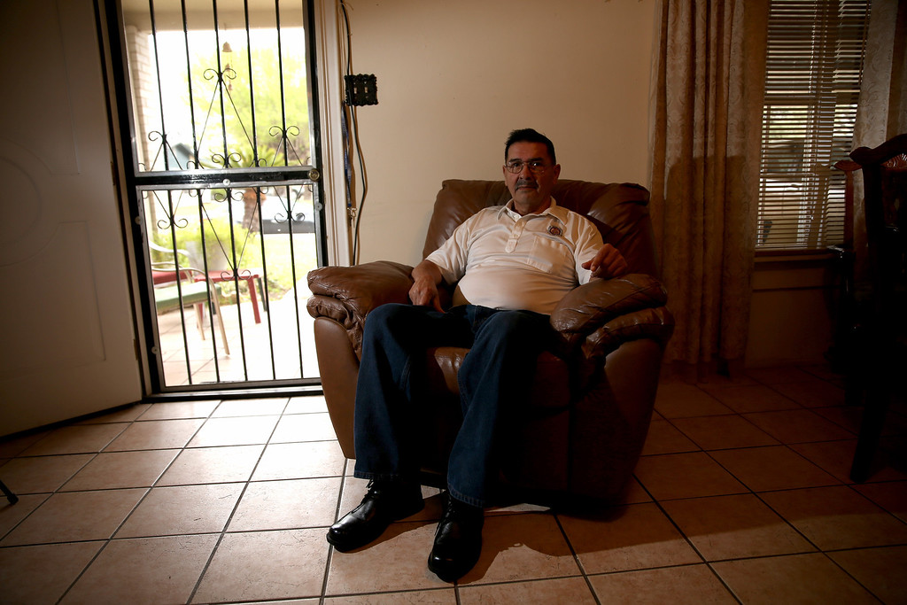 . U.S. Army Specialist Four Santiago J. Erevia, a Vietnam War veteran, sits in his home on March 11, 2014 in San Antonio, Texas.  (Photo by Joe Raedle/Getty Images)
