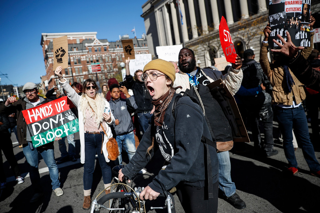 . Protestors chant as they block Main Street outside the Hamilton County Courthouse after a mistrial is declared due to a hung jury in the murder trial against Ray Tensing, Saturday, Nov. 12, 2016, in Cincinnati. Tensing, the former University of Cincinnati police officer, is charged with murdering Sam DuBose while on duty during a routine traffic stop on July 19, 2015. (AP Photo/John Minchillo)