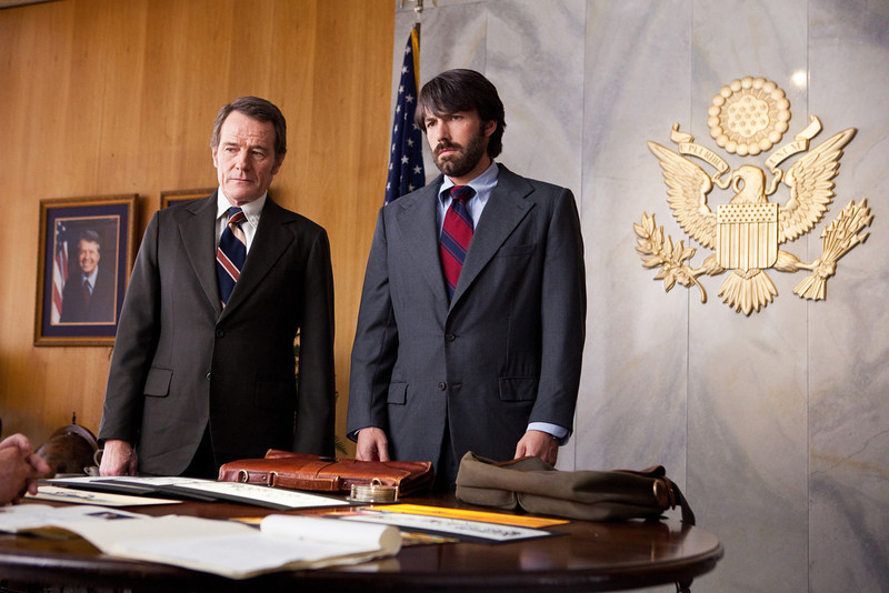 ". This undated publicity film image released by Warner Bros. Pictures shows Bryan Cranston, left, as Jack OíDonnell and Ben Affleck as Tony Mendez in ""Argo,\""  a rescue thriller about the 1979 Iranian hostage crisis.  \""Argo\"" earned a adapted screenplay nomination from the Writers Guild on Friday, Jan. 4, 2013, for outstanding screen writing. (AP Photo/Warner Bros., Claire Folger, File)"