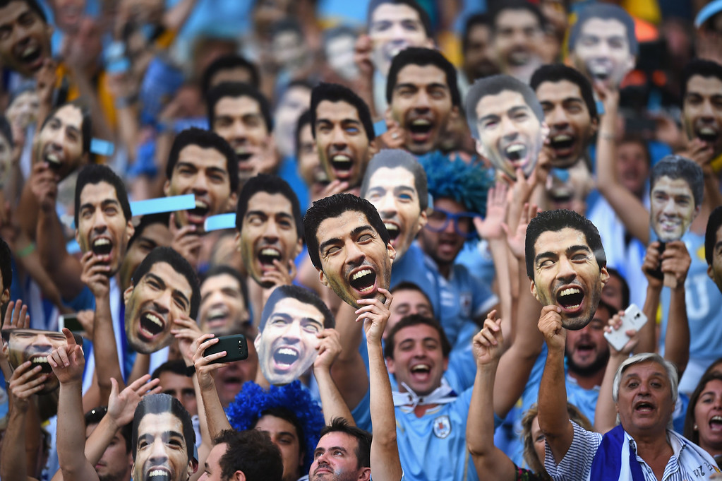 . RIO DE JANEIRO, BRAZIL - JUNE 28:  Uruguay fans hold up and wear Luis Suarez masks ahead of  the 2014 FIFA World Cup Brazil round of 16 match between Colombia and Uruguay at Maracana on June 28, 2014 in Rio de Janeiro, Brazil.  (Photo by Matthias Hangst/Getty Images)