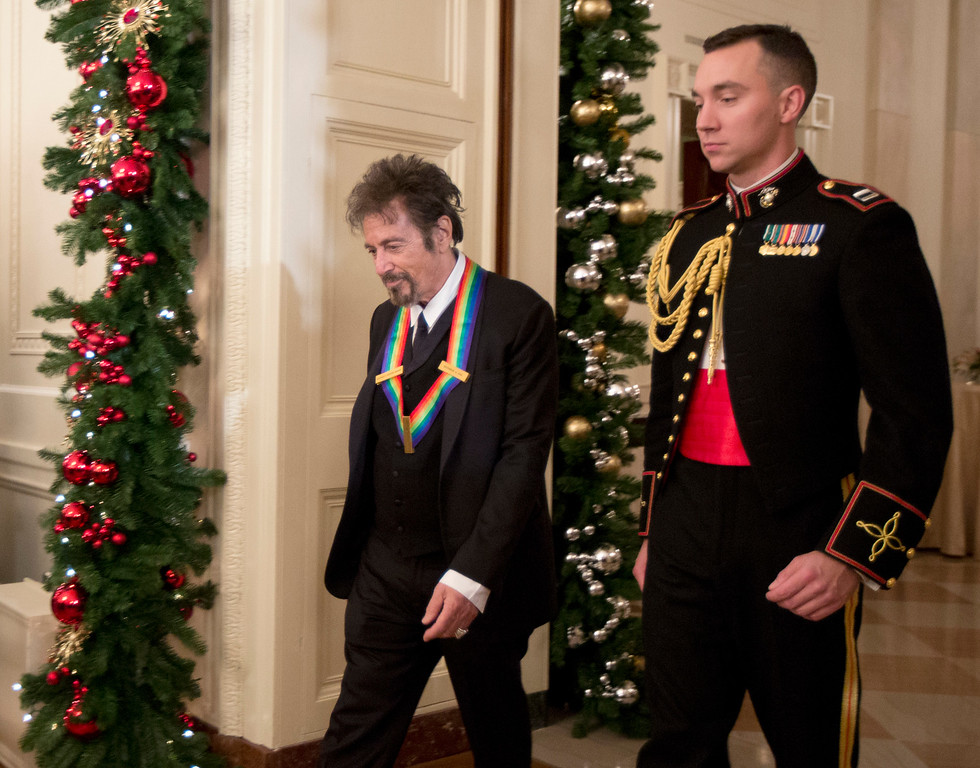 . The recipient of the 2016 Kennedy Center Honors actor Al Pacino, is escorted during a reception in the East Room of the White House in Washington, Sunday, Dec. 4, 2016, hosted by President Barack Obama and first lady Michelle Obama. (AP Photo/Manuel Balce Ceneta)