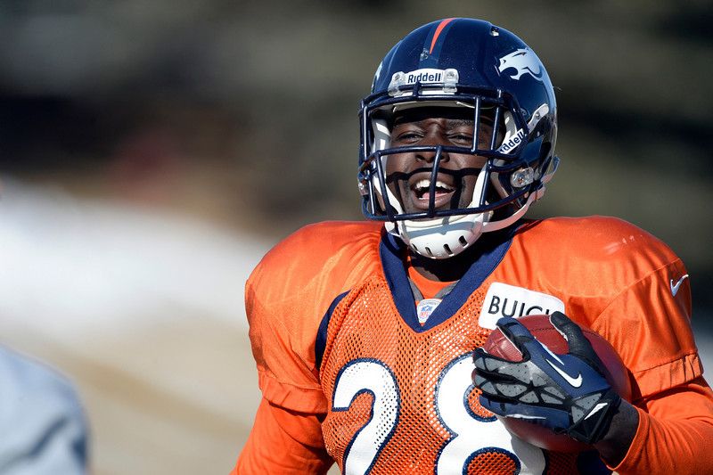 . Denver Broncos running back Montee Ball (28) runs through drills during practice January 8, 2014 at Dove Valley. The Denver Broncos are preparing for their Divisional Game against the San Diego Chargers at Sports Authority Field. (Photo by John Leyba/The Denver Post)