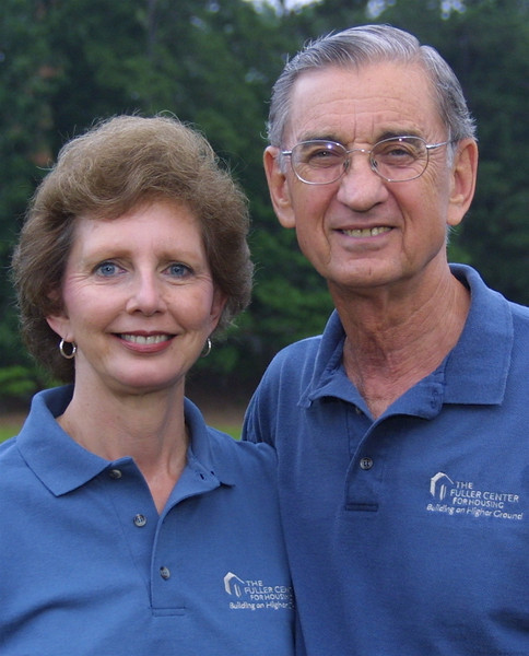 2006 Millard and Linda in new Fuller Center golf shirts (photo made on their property by lake. su