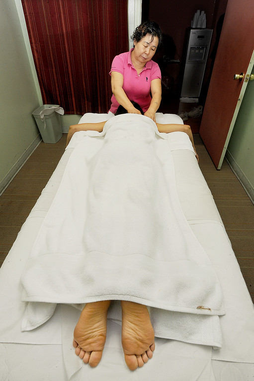 . A massage being given in one of the rooms at LS Massage Acupuncture located at 301 West Valley Boulevard Wednesday, March 25, 2014. (Photo by Walt Mancini/Pasadena Star-News)