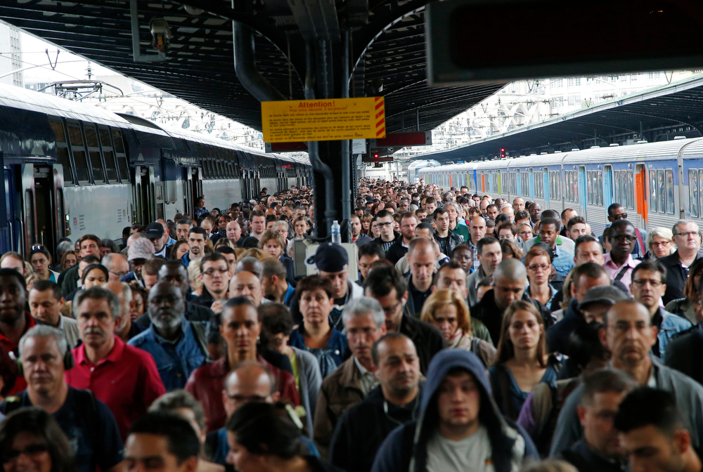 . Commuters arrive at the Gare de l\'Est train station by one of a few trains available today in Paris Tuesday, June 17, 2014 as French rail workers are on strike to protest a reorganization of the national rail and train companies. Seven days into a nationwide train strike that has tangled traffic and stranded tourists, the leftist government is braking a long-held French taboo and is openly criticizing the striking unions. (AP Photo/Michel Euler)