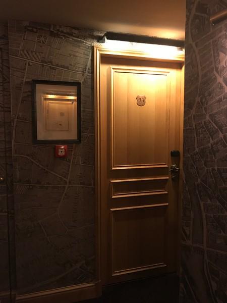 Teeny tiny hallway and our door