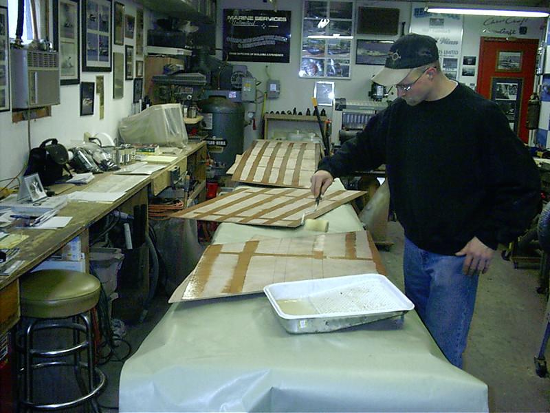 Applying epoxy to plwood side skins.