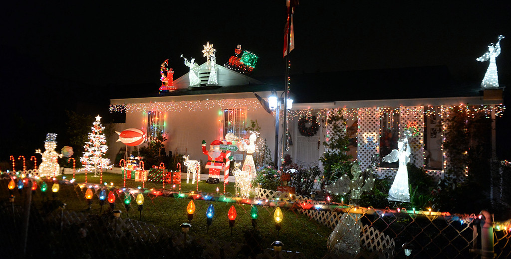 . A home is decorated with holiday lights along Groverdale St. and Lark Ellen in Covina, Calif., on Thursday, Dec. 19, 2013.     (Keith Birmingham Pasadena Star-News)