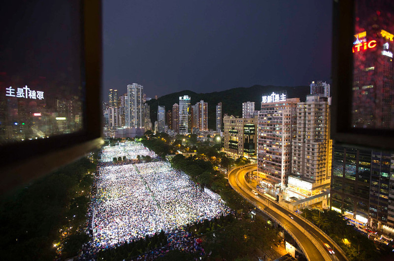 . Tens of thousands of people participate in a candlelight vigil at Hong Kong\'s Victoria Park June 4, 2013, to mark the 24th anniversary of the military crackdown of the pro-democracy movement at Beijing\'s Tiananmen Square in 1989. REUTERS/Tyrone Siu
