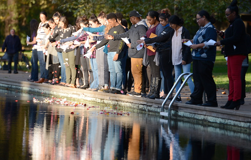 "About 40 people place flower petals in the creek during the ""Flowers on the Creek"" Domestic violence victims remembrance at the One Mile Recreation Area of Bidwell Park in Chico, Calif. Thursday, Oct. 4, 2018.  The program, sponsored by Catalyst Domestic Violence Services, Chico Safe Place, Butte College Safe Place and Wellness Program, and the Butte County Child Abuse Prevention Council is in recognition of October as Domestic Violence Awareness Month. (Bill Husa -- Enterprise-Record)"