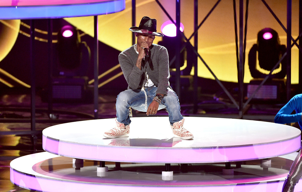 . LOS ANGELES, CA - MAY 01:  Musician Pharrell Williams performs onstage during the 2014 iHeartRadio Music Awards held at The Shrine Auditorium on May 1, 2014 in Los Angeles, California. iHeartRadio Music Awards are being broadcast live on NBC.  (Photo by Kevin Winter/Getty Images for Clear Channel)