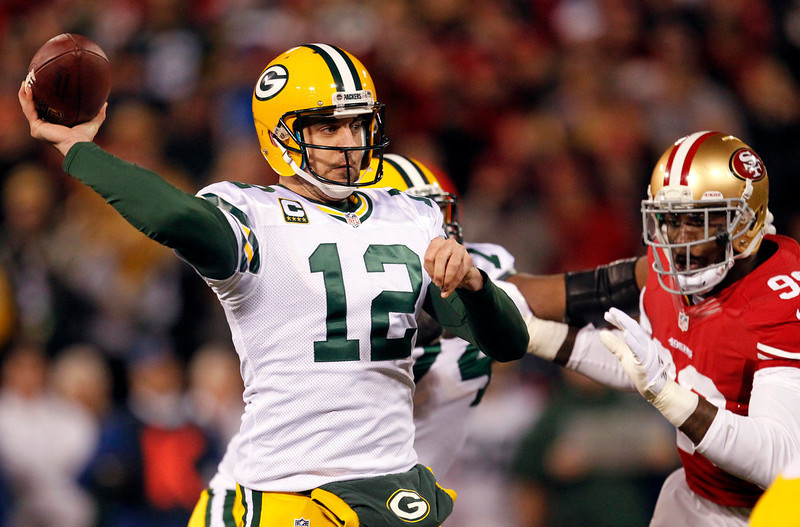 . Green Bay Packers quarterback Aaron Rodgers (12) passes against the San Francisco 49ers during the first quarter of an NFC divisional playoff NFL football game in San Francisco, Saturday, Jan. 12, 2013. (AP Photo/Tony Avelar)