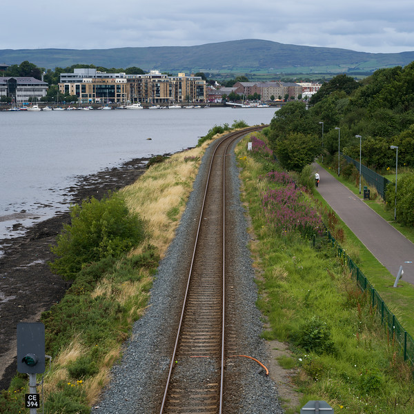 Elevated view of railroad track along river, Republic of Ireland