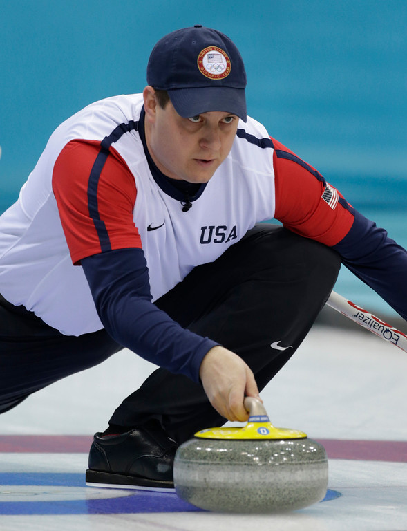 . John Shuster, skip of the United States team, center, delivers the stone during men\'s curling competition against Britain at the 2014 Winter Olympics, Thursday, Feb. 13, 2014, in Sochi, Russia. (AP Photo/Robert F. Bukaty)