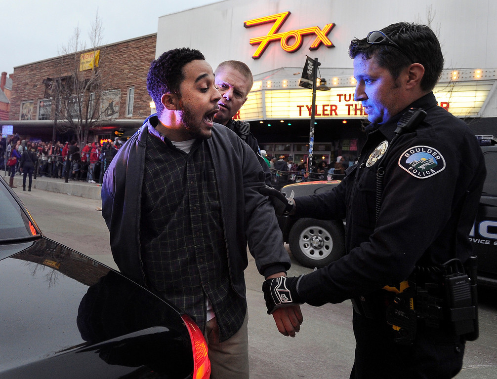. An unidentified man is handcuffed and detained by police during a disturbance at the Fox Theater on Monday, March 11, in Boulder. Boulder Police responded with riot gear to keep the fans of the band Tyler the Creator under control.  Jeremy Papasso/Boulder Daily Camera
