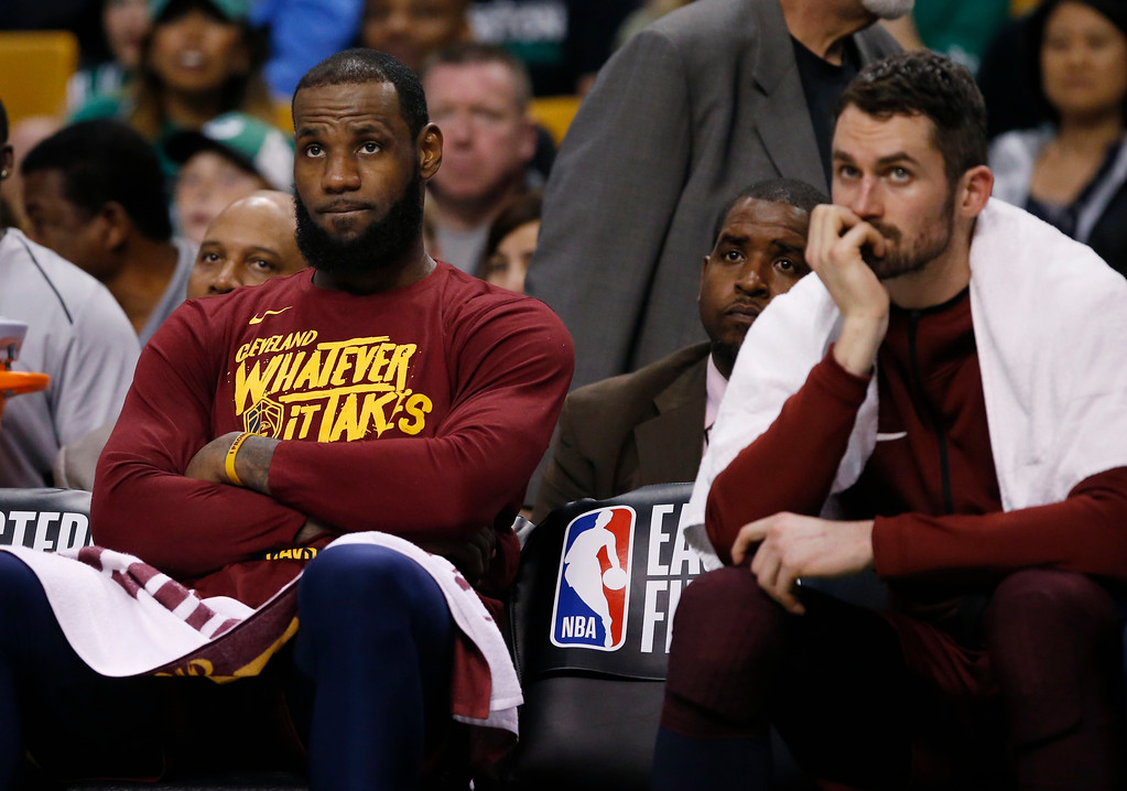 . Cleveland Cavaliers forward LeBron James, left, and center Kevin Love, right, watch from the bench during the fourth quarter of Game 1 of the NBA basketball Eastern Conference Finals against the Boston Celtics, Sunday, May 13, 2018, in Boston. (AP Photo/Michael Dwyer)