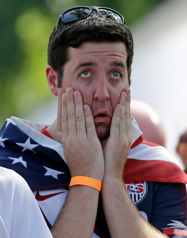 . USA soccer fan Austin Davies of New Orleans reacts during the U.S. soccer team\'s loss to Belgium at a viewing site outside Finn McCool\'s Irish Pub in New Orleans, Tuesday, July 1, 2014. The U.S. lost 2-1 in extra time. (AP Photo/Gerald Herbert)