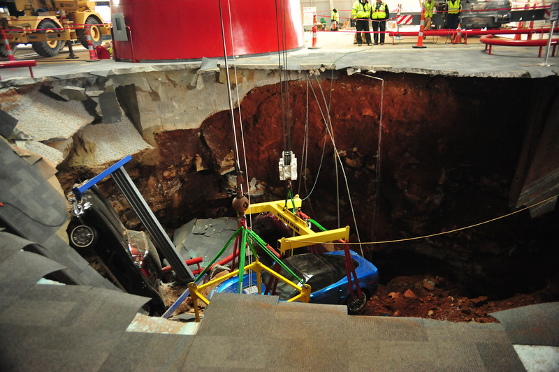 Construction firm employees going into the sinkhole to begin to recover 2009 ZR1 Corvette   Permission given to use this image with credit to the National Corvette Museum
