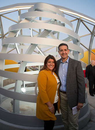 09/18/19 Wesley Bunnell | StaffrrThe Bee Hive Bridge was formally dedicated on Thursday night with the unveiling of the beehive sculpture and the reveal of the different color lights on the bridge panels. Mayor Erin Stewart and Sign Pro Owner Peter Rappoccio in front of the beehive sculpture.