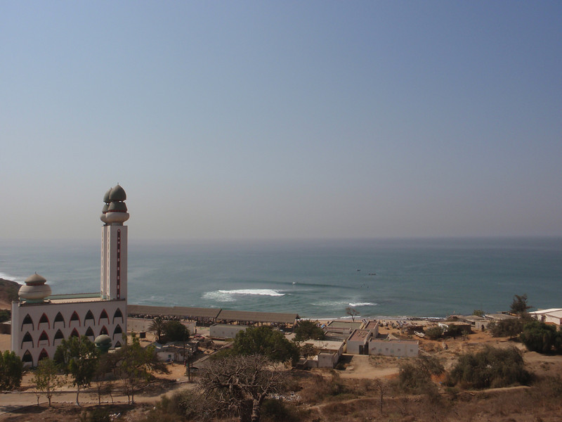 037_The Mosquee de la Divinite perched on a calm stretch of shore.jpg