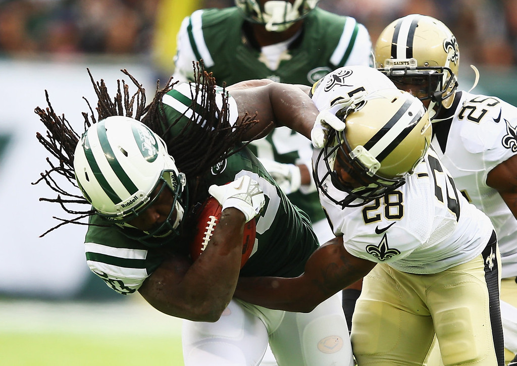 . Chris Ivory #33 of the New York Jets runs against  Keenan Lewis #28 of the New Orleans Saints during their game at MetLife Stadium on November 3, 2013 in East Rutherford, New Jersey.  (Photo by Al Bello/Getty Images)