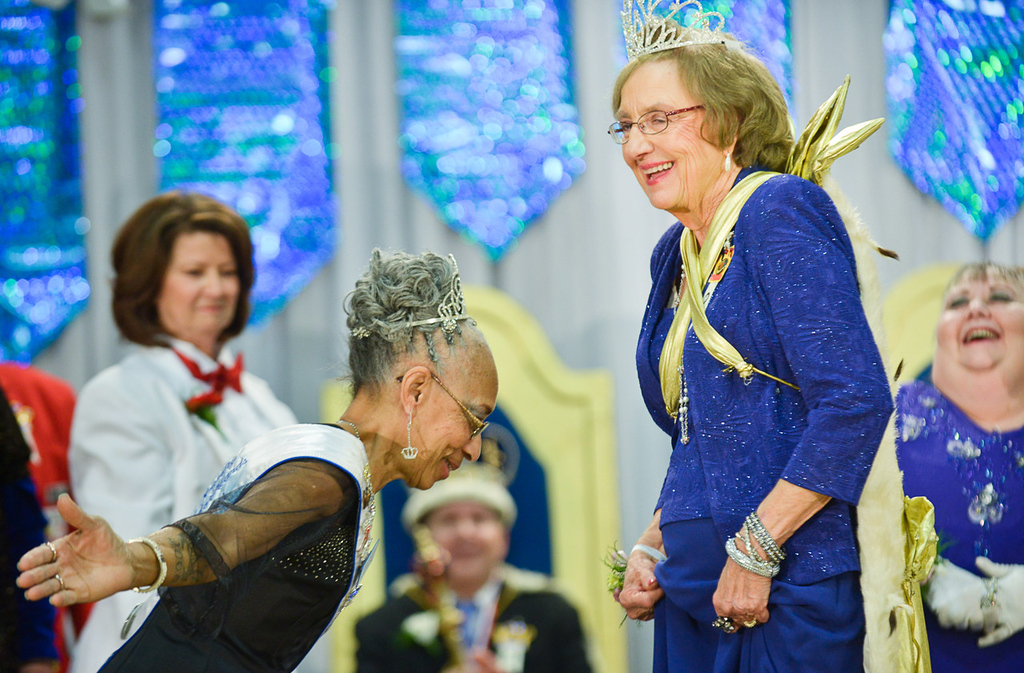 . Jackye Whitner, left, the outgoing 2013 Queen of the Northlands, pays deference to the new queen, Gerry Schulz, during the Senior Royalty Coronation ceremony. (Pioneer Press: Ben Garvin)