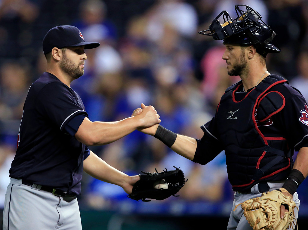 . Cleveland Indians relief pitcher Nick Goody, left, celebrates with catcher Yan Gomes following a baseball game against the Kansas City Royals at Kauffman Stadium in Kansas City, Mo., Friday, Aug. 18, 2017. The Indians defeated the Royals 10-1. (AP Photo/Orlin Wagner)