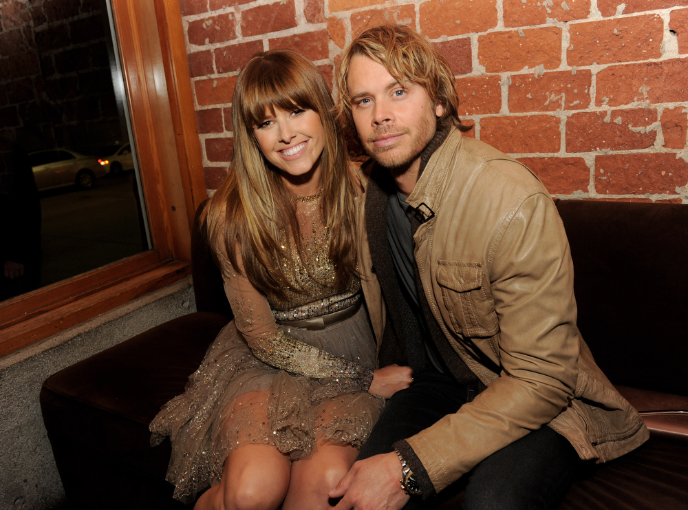 """. Actress Sarah Wright (L) and husband actor Eric Christian Olsen pose at the after party for the premiere of Relativity Media\'s \""""21 And Over\"""" at the Westwood Brewery on February 21, 2013 in Los Angeles, California.  (Photo by Kevin Winter/Getty Images)"""