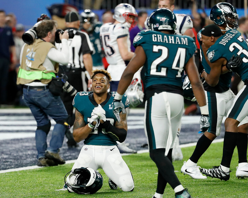 . Philadelphia Eagles\' Rodney McLeod, bottom, celebrates after the NFL Super Bowl 52 football game against the New England Patriots Sunday, Feb. 4, 2018, in Minneapolis. The Eagles won 41-33. (AP Photo/Matt York)