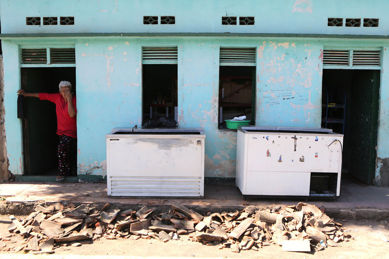 . A woman stays at the door of her home damaged by an earthquake in Nagarote, some 40 Km from Managua, on April 11, 2014. A 6.2-magnitude earthquake that struck Nicaragua killed one person, left 33 injured and damaged more than 800 homes, the government said Friday. (Inti Ocon/AFP/Getty Images)