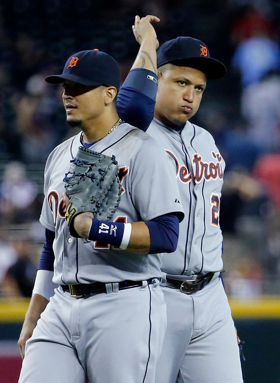 . Detroit Tigers\' Miguel Cabrera, right, and Victor Martinez celebrate their win over the Arizona Diamondbacks after a baseball game, Wednesday, July 23, 2014, in Phoenix. The Tigers won 11-5. (AP Photo/Matt York)