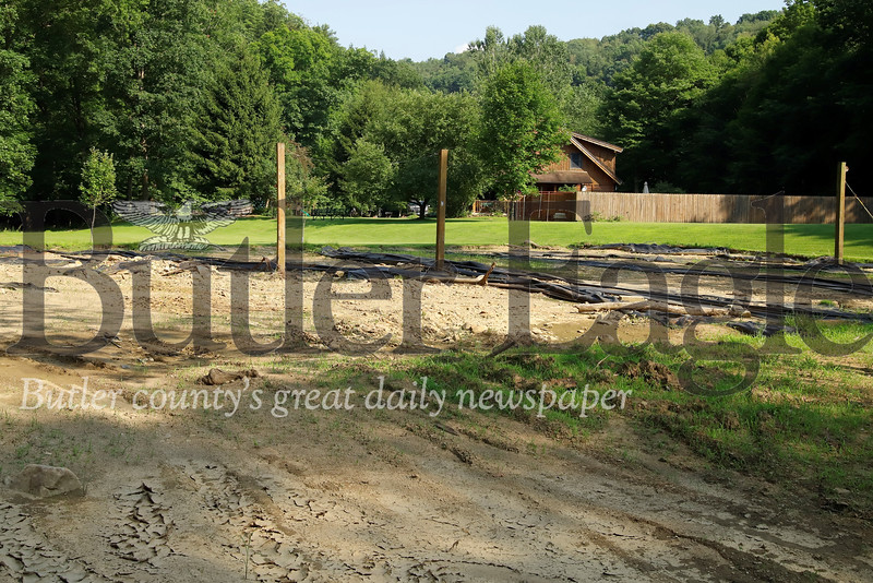 What remains of Tom Phillips' sand volleyball court following flooding of Little Buffalo Creek. Seb Foltz/Butler Eagle