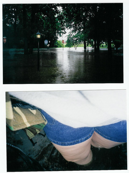 5-6-03 water in garage and knee high in front yard.jpg