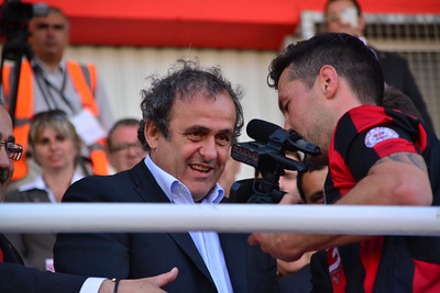 UEFA President Michell Platini presents the Rock Cup to Lincoln Red Imps Capatin and sees himself being filmed by the player after the excitment of being the first team to win the cup since Gibraltar joined UEFA takes over. The unprecedented actions were met with surprise by the UEFA president who smiled as he was being filmed close-up.