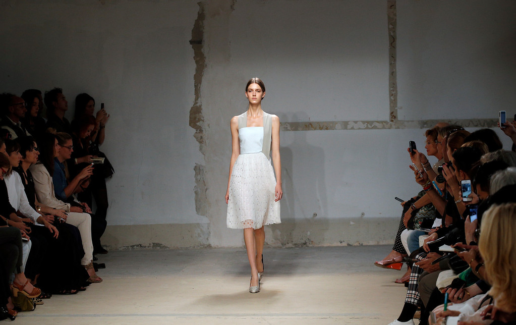 . A model presents a creation as part of German fashion designer Damir Doma\'s ready-to-wear Spring/Summer 2014 fashion collection presented in Paris, Wednesday, Sept. 25, 2013. (AP Photo/Christophe Ena)