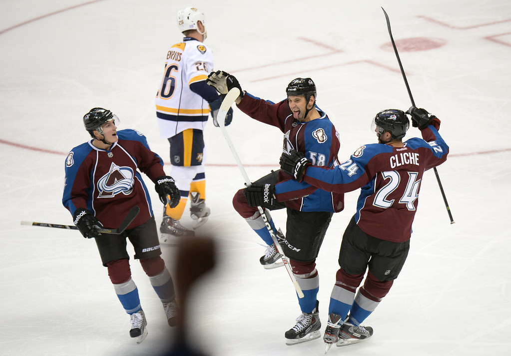 . DENVER, CO - OCTOBER 04 : Patrick Bordeleau of the Colorado Avalanche (58) celebrates his goal with his teammates Tyson Barrie (4) and Marc-Andre Clinche (24) in front of Matt Hendricks of the Nashville Predators (26) in the 2nd period of the game at the Pepsi Center. Denver, Colorado. October 4, 2013. (Photo by Hyoung Chang/The Denver Post)