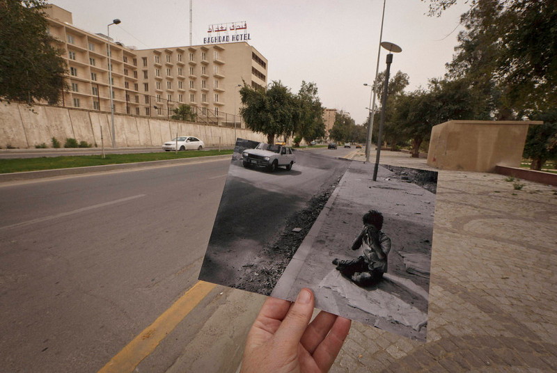 . Abu Nawas Street in Baghdad, Iraq, at the site of a photograph of Iraqi orphan Fady al-Sadik waking on the street taken by photographer Maya Alleruzzo in April, 2003. The park that runs along Abu Nawas Street, named for an Arabic poet, is now a popular destination for families who are drawn by the manicured gardens, playgrounds and restaurants famous for a fish called mazgouf. Ten years ago, the park was home to a tribe of children orphaned by the war and was rife with crime. Photo taken on March 12, 2013. (AP Photo/Maya Alleruzzo)