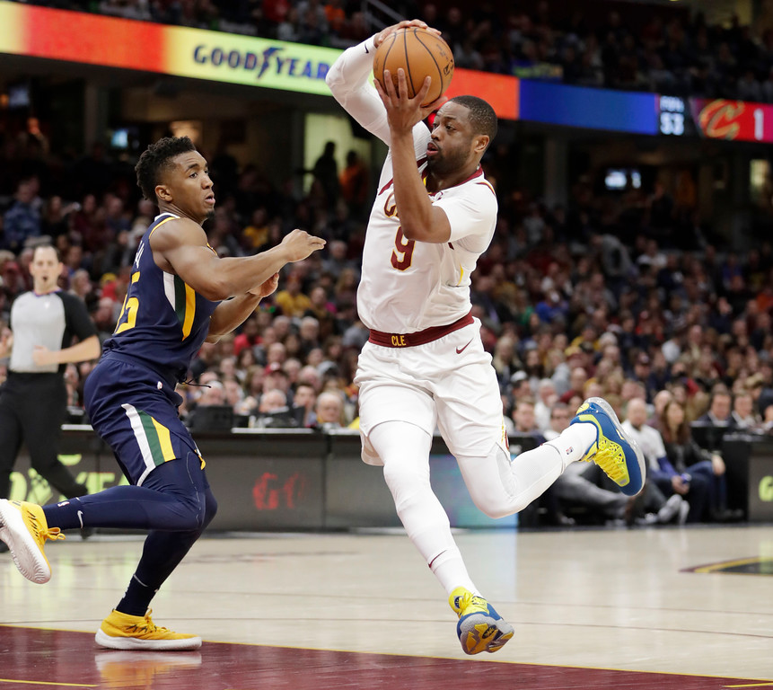 . Cleveland Cavaliers\' Dwyane Wade (9) drives past Utah Jazz\'s Donovan Mitchell (45) in the second half of an NBA basketball game, Saturday, Dec. 16, 2017, in Cleveland. (AP Photo/Tony Dejak)