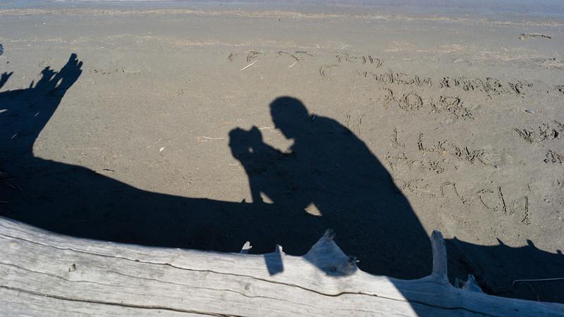 Shadow of person at lakeside, Jasper Lake, Yellowhead Highway, Jasper National Park, Jasper, Alberta, Canada