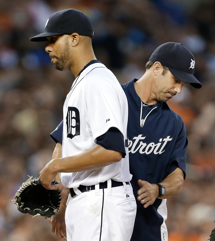 . Detroit Tigers pitcher David Price, left, is taken out of a baseball game by manager Brad Ausmus in the third inning of a baseball game against the New York Yankees in Detroit, Wednesday, Aug. 27, 2014. Price allowed eight earned runs. (AP Photo/Paul Sancya)