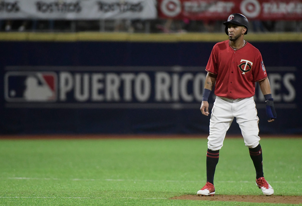 . Minnesota Twins outfielder Eddie Rosario tries to steal third base during the fourth inning of game one, of a two-game MLB Series, against the Cincinnati Indians at Hiram Bithorn Stadium in San Juan, Puerto Rico, Tuesday, April 17, 2018. (AP Photo/Carlos Giusti)